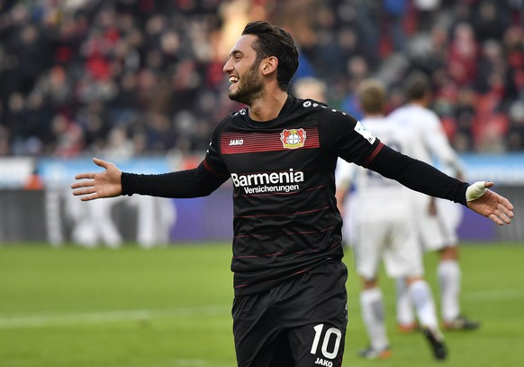 FILE - In this file photo dated Sunday, Jan. 22, 2017, Leverkusen's Hakan Calhanoglu celebrates after scoring from a penalty during the German Bundesliga soccer match between Bayer Leverkusen and Hertha BSC Berlin in Leverkusen, Germany.  22-year old Bayer Leverkusen midfielder Hakan Calhanoglu will serve a four-month ban and pay a fine imposed by FIFA for breach of contract, the Court of Arbitration for Sport ruled Thursday Feb. 2, 2017. (AP Photo/Martin Meissner, FILE)