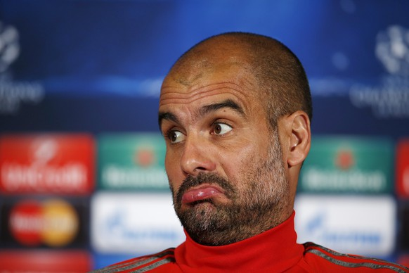 Bayern Munich manager Pep Guardiola reacts during a news conference in Porto April 14, 2015. Bayern Munich will play their Champions League quarter-final first leg soccer match against Porto on Wednesday. REUTERS/Rafael Marchante