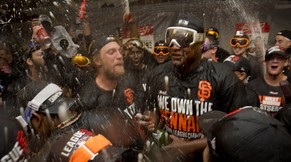 San Francisco Giants' Hunter Pence, center left, leads the team in a cheer during the celebration in the locker room after the Giants defeated the St. Louis Cardinals 6-3 in Game 5 of baseball's NL Championship Series, Thursday, Oct. 16, 2014, in San Francisco. The Giants advanced to the World Series. (AP Photo/The Sacramento Bee, Jose Luis Villegas)