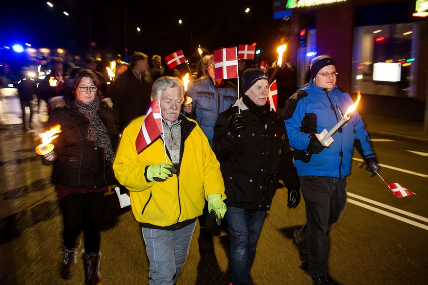 Anti-Islam protesters, PEGIDA Denmark, attend a protest rally in Esbjerg on January 19, 2015. Pegida stands for