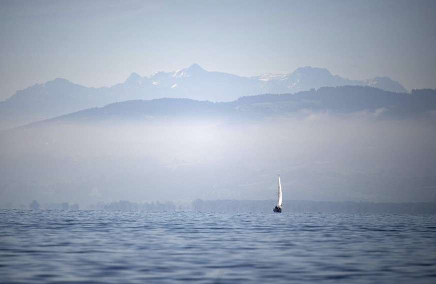 A boat sails in front of the Alps over the Lake Constance (Bodensee), southern Germany, Friday, Sept. 13, 2019. (Marijan Murat/dpa via AP)