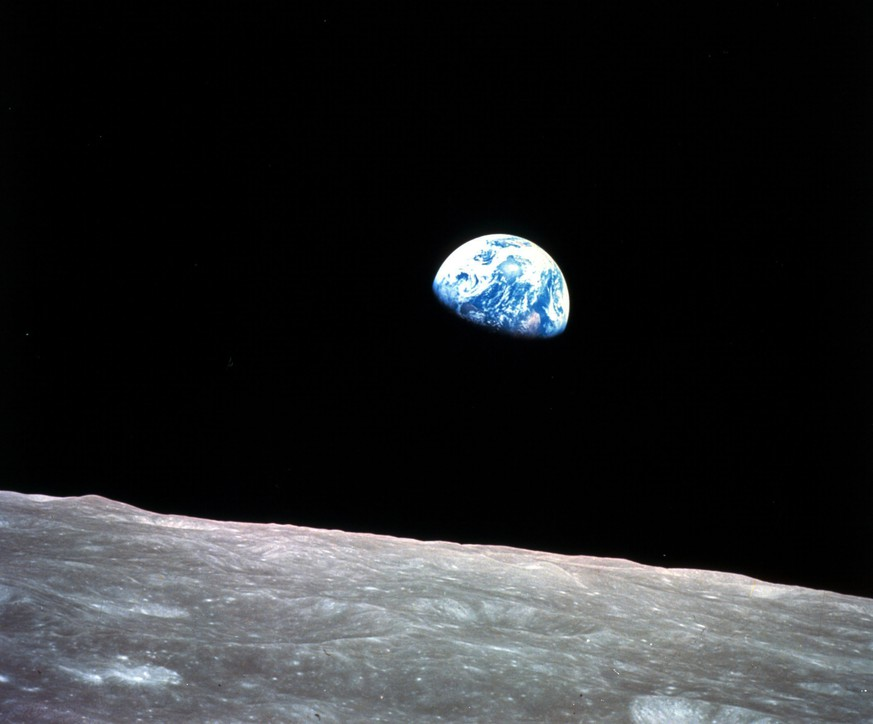 FILE - This Dec. 24, 1968, file photo made available by NASA shows the Earth behind the surface of the moon during the Apollo 8 mission. (William Anders/NASA via AP, File)