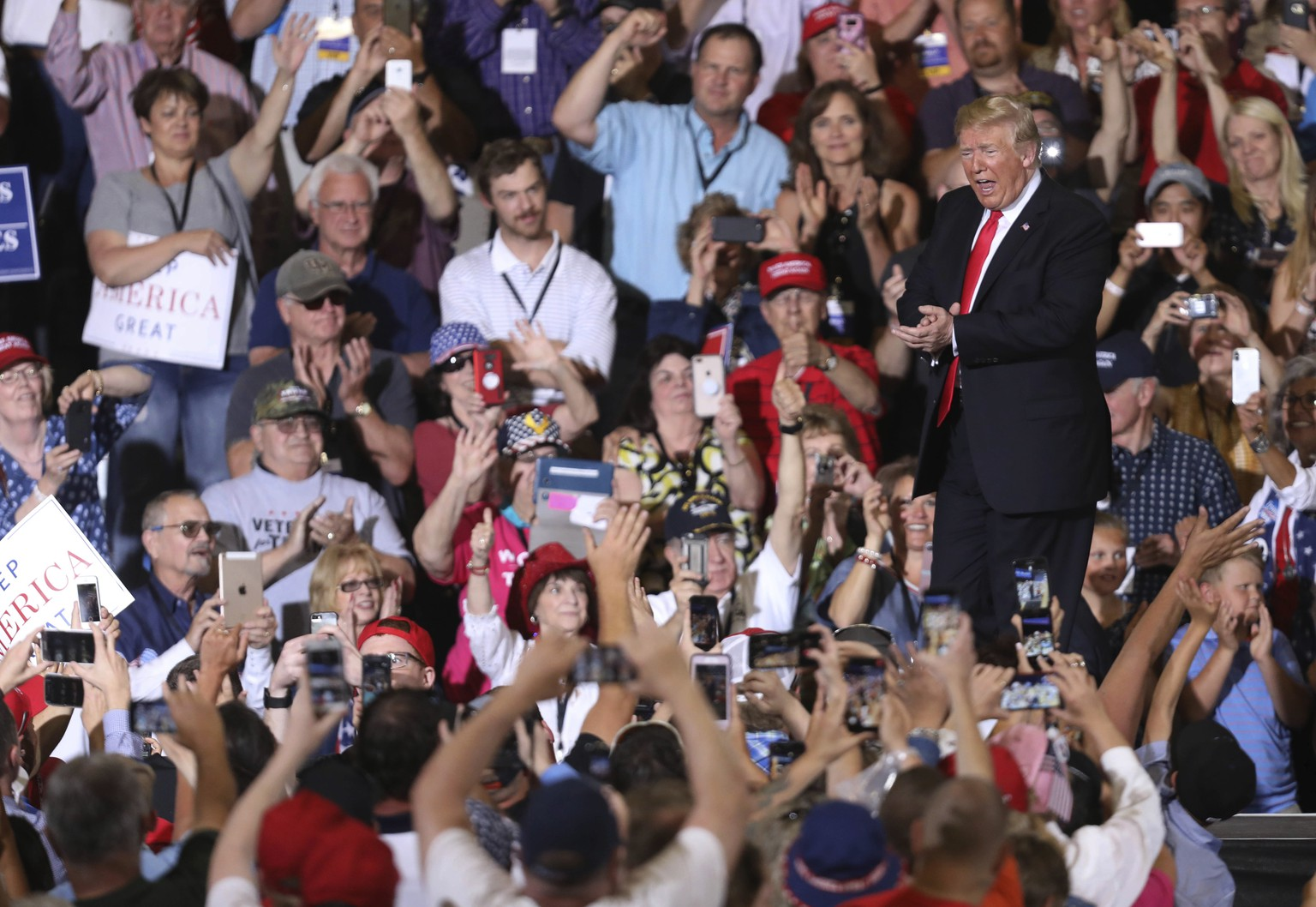 President Donald Trump applauds the audience after his remarks during a rally at the Four Seasons Arena at Montana ExpoPark, Thursday, July 5, 2018, in Great Falls, Mont., in support of Rep. Greg Gianforte, R-Mont., and GOP Senate candidate Matt Rosendale. (AP Photo/Jim Urquhart)