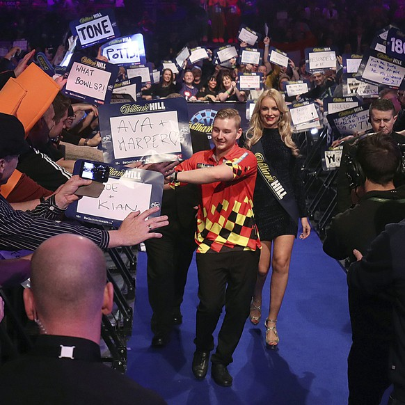 Belgian's Dimitri Van den Bergh on his walk in, during day thirteen of the William Hill World Darts Championship at Alexandra Palace, London, Friday, Dec. 29, 2017. (Adam Davy/PA via AP)