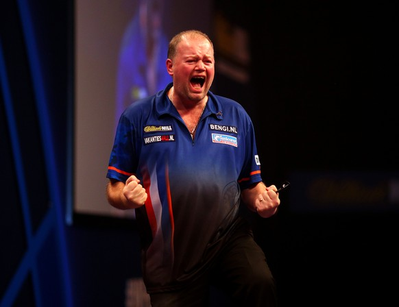 LONDON, ENGLAND - DECEMBER 30: Raymond van Barneveld of Holland celebrates winning his third round match against Adrian Lewis of England during the William Hill PDC World Darts Championships on Day Ten at Alexandra Palace on December 30, 2014 in London, England. (Photo by Charlie Crowhurst/Getty Images)