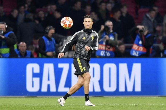 Juventus' Cristiano Ronaldo warms up ahead of the Champions League quarterfinal, first leg, soccer match between Ajax and Juventus at the Johan Cruyff ArenA in Amsterdam, Netherlands, Wednesday, April 10, 2019. (AP Photo/Martin Meissner)
