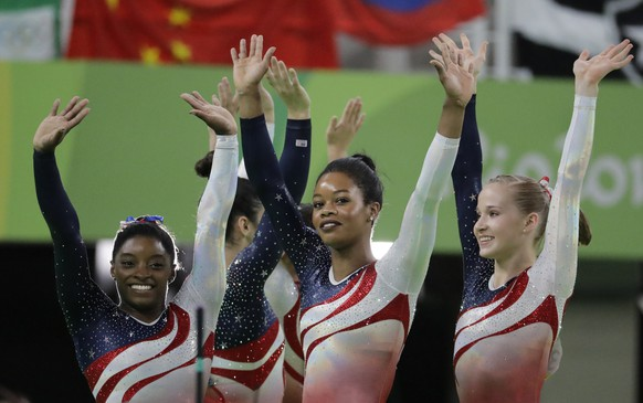 U.S. gymnasts, left to right, Simone Biles, Gabrielle Douglas and Madison Kocian wave to the audience at the end of the artistic gymnastics women's team final at the 2016 Summer Olympics in Rio de Janeiro, Brazil, Tuesday, Aug. 9, 2016. (AP Photo/Charlie Riedel)