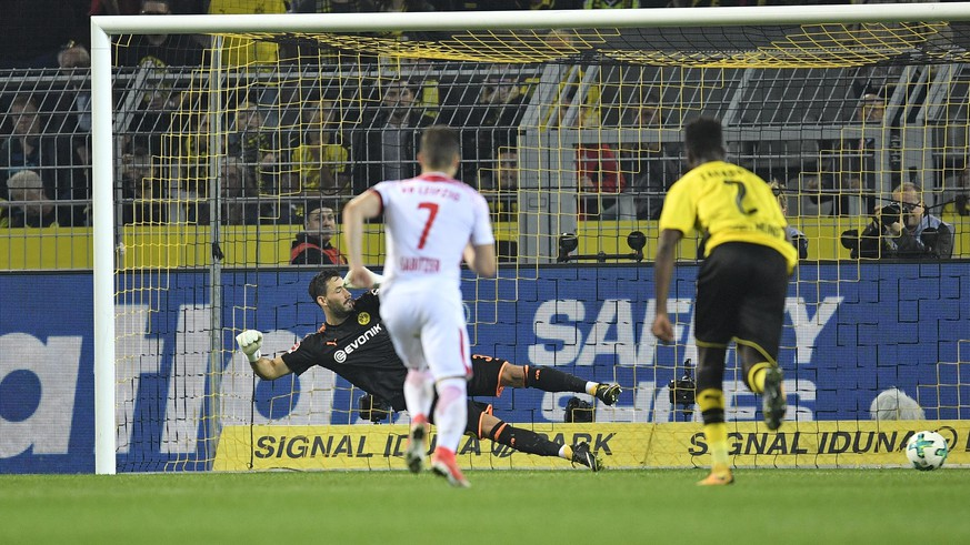 Leipzig's Jean-Kevin Augustin, left, scores a penalty goal against Dortmund goalkeeper Roman Buerki during the German Bundesliga soccer match between Borussia Dortmund and RB Leipzig in Dortmund, Germany, Saturday, Oct. 14, 2017. (AP Photo/Martin Meissner)