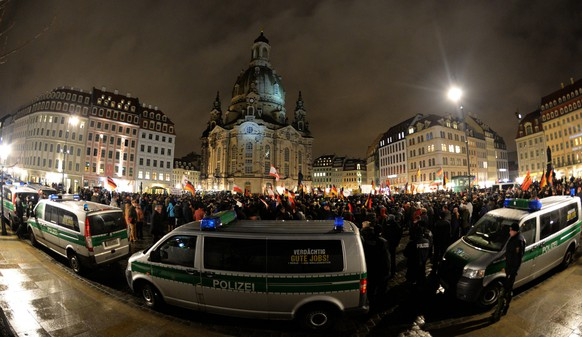 epa04612122 Members of the anti-Islamic Pegida alliance gather in Dresden, Germany, 09 February 2015. The 'Patriotic Europeans against the Islamization of the West' have called for a rally in Saxony's capital after a split in the movement.  EPA/ARNO BURGI