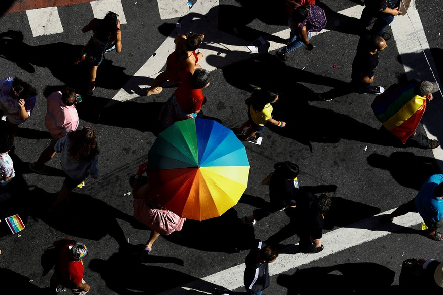 epaselect epa07669220 People participate in the 23rd edition of the LGBT Pride Parade, on Paulista Avenue in Sao Paulo, Brazil, 23 June 2019. Thousands of people gathered this Sunday at the iconic Paulista Avenue, the most emblematic street in Sao Paulo, to celebrate the LGBT Pride 2019, which in its twenty-third edition pays tribute to the 50 years of the Stonewall conflict, a milestone in the struggle for the rights of this group.  EPA/MARCELO CHELLO