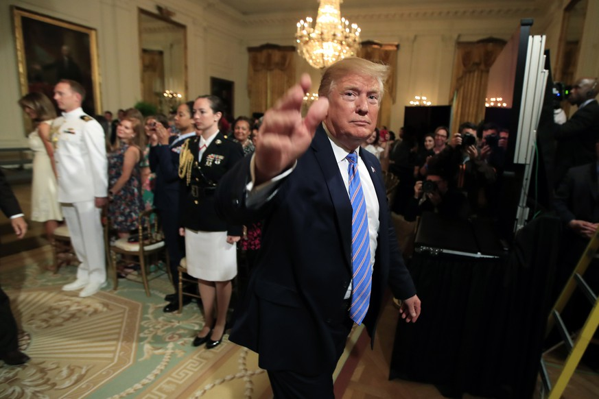 President Donald Trump waves as he leaves the East Room during a celebration of military mothers with first lady Melania Trump at the White House in Washington, Friday, May 10, 2019. (AP Photo/Manuel Balce Ceneta)