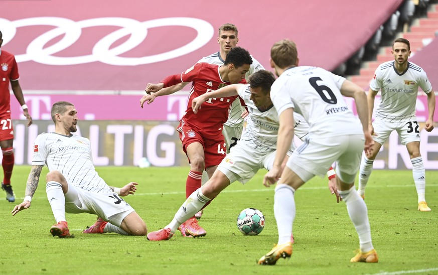 Bayern's Jamal Musiala, center, scores his side's opening goal during the German Bundesliga soccer match between Bayern Munich and FC Union Berlin at Allianz Arena in Munich, Germany, Saturday, April 10, 2021.(Sven Hoppe/Pool via AP)
