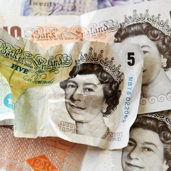 epa05455002 The British Pound in London, Britain, 04 August 2016. Pound Sterling dropped against the US Dollar and the Euro ahead of the expected Bank of England Interest Rate cut, 04 August. The currency continues to trade at around 31-year lows against the dollar.  EPA/ANDY RAIN
