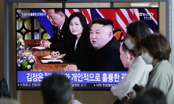 People watch a TV news program reporting about North Korea with file footage of North Korean leader Kim Jong Un, at the Seoul Railway Station in Seoul, South Korea, Saturday, April 13, 2019. North Korean leader Kim Jong Un said he is open to a third summit with President Donald Trump, but set the year's end as a deadline for Washington to offer mutually acceptable terms for an agreement to salvage the high-stakes nuclear diplomacy, the state-run media said Saturday. The letters read at the top,