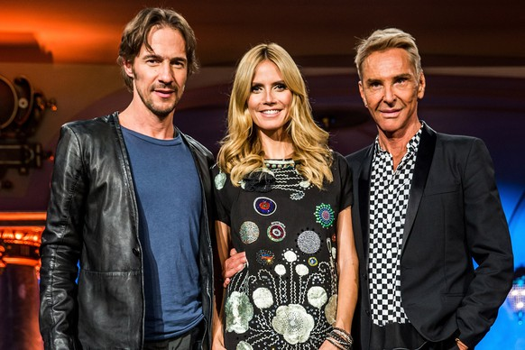 HEIDELBERG, GERMANY - MAY 10:  (L-R) Thomas Hayo, Heidi Klum and Wolfgang Joop pose during a photo call for the tv show 'Germany's Next Topmodel' on May 10, 2015 in Heidelberg, Germany. The final of the 10th GNTM season will air on May 14, 2015 on the television network ProSieben.  (Photo by Simon Hofmann/Getty Images)