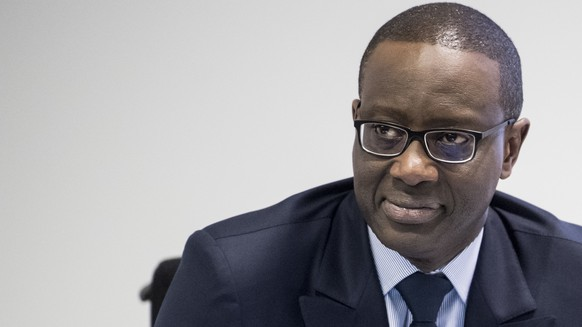 Tidjane Thiam, CEO of Swiss bank Credit Suisse, smiles prior to the press conference of the full-year results of 2017 in Zurich, Switzerland, Wednesday, Feb. 14, 2018. (Ennio Leanza/Keystone via AP)