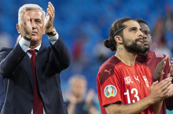Switzerland's head coach Vladimir Petkovic, defender Ricardo Rodriguez and midfielder Denis Zakaria, from left, take leave of their supporters after the UEFA Euro 2020 soccer tournament quarterfinal soccer match between Switzerland and Spain at the Saint Petersburg stadium, in St. Petersburg, Russia, Friday, July 2, 2021. (KEYSTONE/Jean-Christophe Bott)