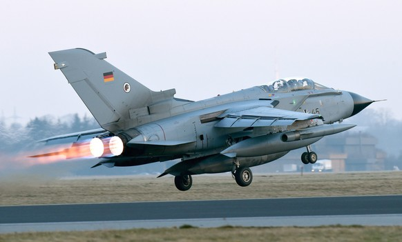 epa05088224 One of two German Air Force (Luftwaffe) 'Tornado' reconnaissance jets takes off for the NATO air bace in Incirlik, Turkey, as part of their mission against the militant group of the so-called 'Islamic State' (IS), at the airbase in Jagel, Germany, 05 January 2016. The two aircraft are part of a total of four 'Tornado' reconnaissance jets which Germany is to deploy to help fight IS militia in Syria. Two other 'Tornado' jets started from the Buechel, Germany, air base the same day.  EPA/CARSTEN REHDER
