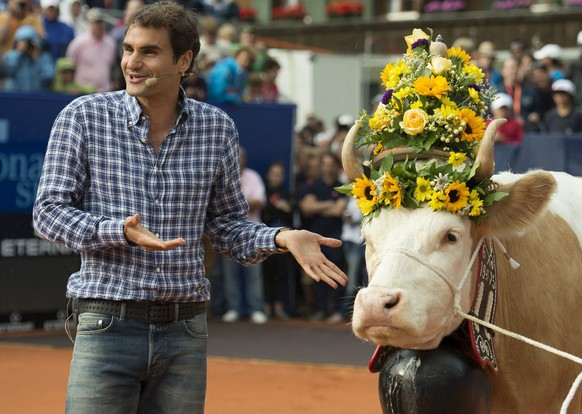 Swiss tennis player Roger Federer with his cow