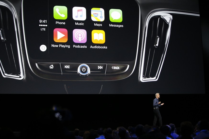 Craig Federighi, Apple senior vice president of software engineering, speaks about iOS10 at the Apple Worldwide Developers Conference in the Bill Graham Civic Auditorium in San Francisco, Monday, June 13, 2016. (AP Photo/Tony Avelar)