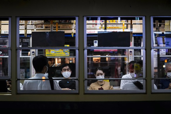 epa08589856 Passengers wearing protective face masks are seen in a tram in central Nagasaki, southern Japan, 07 August 2020. Nagasaki is preparing to mark the 75th anniversary of the atomic bombing on 09 August as related events are either canceled or scaled down this year to avoid the spreading of the coronavirus disease (COVID-19) pandemic. In 1945 the United States dropped two nuclear bombs over the cities of Hiroshima and Nagasaki on 06 and 09 August respectively, killing more than 200,000 people.  EPA/DAI KUROKAWA
