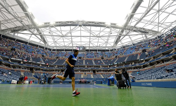 Sep 13, 2015; New York, NY, USA; Rain delays the start of the men's singles final on day fourteen of the 2015 U.S. Open tennis tournament at USTA Billie Jean King National Tennis Center. Mandatory Credit: Robert Deutsch-USA TODAY Sports