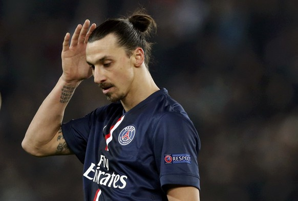 Paris St Germain's Zlatan Ibrahimovic reacts during the Champions League round of 16 first leg soccer match against Chelsea at the Parc des Princes Stadium in Paris February 17, 2015.      REUTERS/Christian Hartmann (FRANCE  - Tags: SPORT SOCCER)