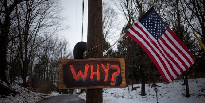 FILE PHOTO: A sign is posted on an electricity pole outside a house near Sandy Hook Elementary School, nearly two weeks after a gunman shot dead 20 students and six adults, in Newtown, Connecticut December 27, 2012.  REUTERS/Adrees Latif/File Photo