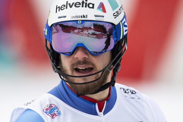 epa07296232 Luca Aerni of Switzerland reacts in the finish area during the slalom run of the men's Alpine Combined race at the FIS Alpine Skiing World Cup in Wengen, Switzerland, 18 January 2019.  EPA/JEAN-CHRISTOPHE BOTT