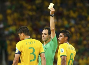 Brazil's Thiago Silva is shown the yellow card during the 2014 World Cup quarter-finals between Brazil and Colombia at the Castelao arena in Fortaleza July 4, 2014. REUTERS/Yves Herman (BRAZIL  - Tags: SOCCER SPORT WORLD CUP)
