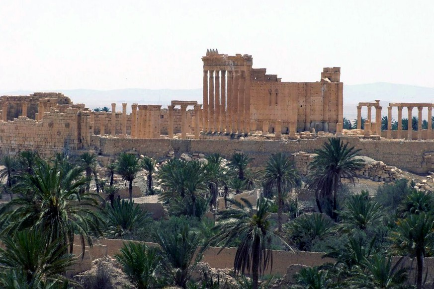 FILE - This FILE photo released on Sunday, May 17, 2015, by the Syrian official news agency SANA, shows the general view of the ancient Roman city of Palmyra, northeast of Damascus, Syria.  Islamic State militants seized parts of the ancient town of Palmyra in central Syria on Wednesday after fierce clashes with government troops, renewing fears the extremist group would destroy the priceless archaeological site if it reaches the ruins. (SANA via AP, File)