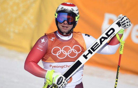 epa06526229 Beat Feuz of Switzerland reacts after the Men's Downhill race at the Jeongseon Alpine Centre during the PyeongChang 2018 Olympic Games, South Korea, 15 February 2018.  EPA/FILIP SINGER