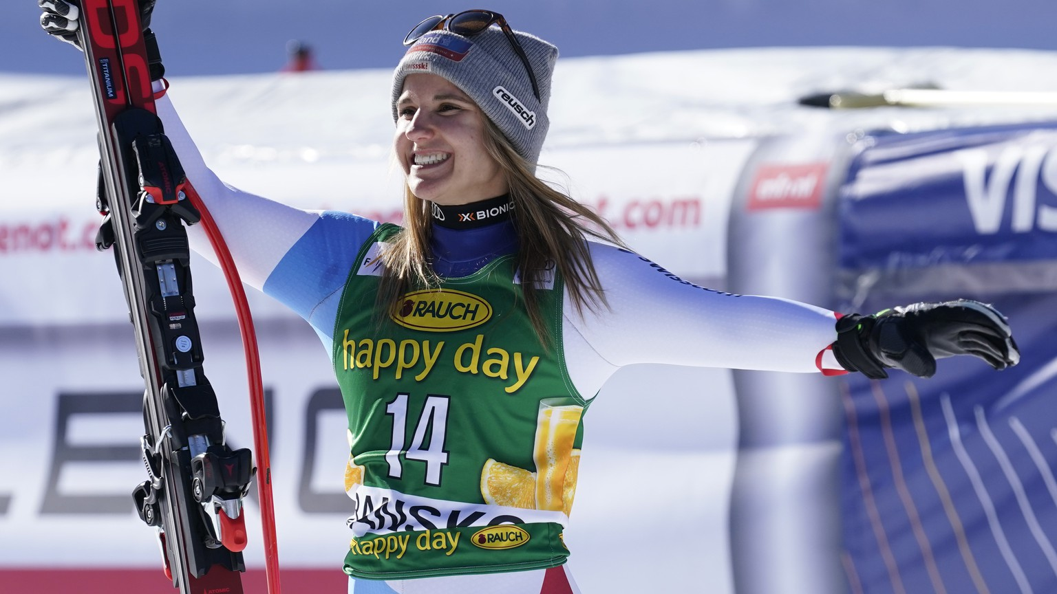 Switzerland's Joana Haehlen celebrates on the podium her third place after an alpine ski, women's World Cup downhill, in Bansko, Bulgaria, Friday, Jan. 24, 2020. (AP Photo/Giovanni Auletta)