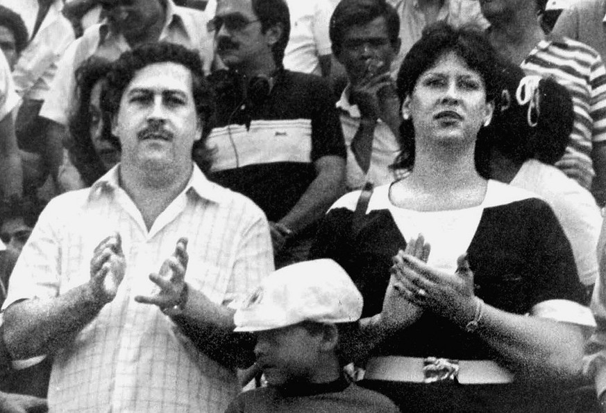 FILE--Pablo Escobar, left, boss of the Medellin drug cartel, is shown with his wife, Victoria Henau Vallejos, right, and son while attending a soccer match in Bogota, Colombia in this undated file photo. U.S. experts played an extensive role in funding and guiding the Colombian authorities who hunted down and killed cocaine lord  Escobar, according to an investigation by The Philadelphia Inquirer. (AP Photo/El Tiempo, File)