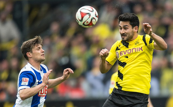 epa04740469 Dortmund's Ilkay Guendogan (R) in action against Berlin's Valentin Stocker (L) during the German Bundesliga soccer match between Borussia Dortmund and Hertha BSC Berlin in Dortmund, Germany, 09 May 2015.   (EMBARGOCONDITIONS - ATTENTION - Due to the accreditation guidelines, the DFLonly permits the publication and utilisation of up to 15 pictures per match on the internet and in online media during the match)  EPA/MAJA HITIJ