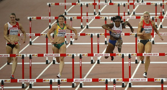 Switzerland's Noemi Zbaeren, Australia's Michelle Jenneke, Britain's Tiffany Porter and Germany's Cindy Roleder, from left, compete in a women's 100m hurdles semifinal at the World Athletics Championships at the Bird's Nest stadium in Beijing, Friday, Aug. 28, 2015. (AP Photo/Mark Schiefelbein)