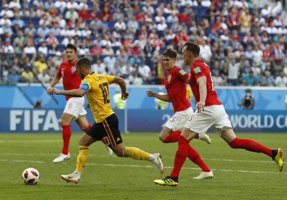 Belgium's Eden Hazard prepares to score his side's second goal during the third place match between England and Belgium at the 2018 soccer World Cup in the St. Petersburg Stadium in St. Petersburg, Russia, Saturday, July 14, 2018. (AP Photo/Petr David Josek)