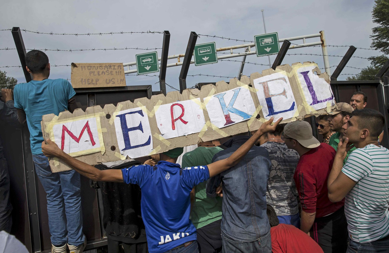 File photo of migrants holding a banner reading