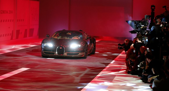 A special edition of a Bugatti Veyron is presented during a Volkswagen Group Night event ahead of the 84th Geneva Motor Show in Geneva late March 3, 2014. The Geneva Motor Show will run from March 6 to 16. REUTERS/Arnd Wiegmann (SWITZERLAND - Tags: TRANSPORT BUSINESS)