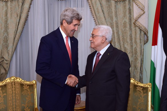 epa04443771 A photograph supplied by the Palestinian Authority shows Palestinian President Mahmoud Abbas (R) as he meets with US Secretary State John Kerry (L), on the sidelines of the Gaza Donor Conference in Cairo, Egypt, 12 October 2014. The conference is aimed at raising billions of dollars to fund the reconstruction of damaged homes and infrastructure in the Gaza Strip following Israel's 50-day war against the Hamas militants.  EPA/THAER GHANAIM/ PALESTINIAN AUTHORITY / HANDOUT  HANDOUT EDITORIAL USE ONLY/NO SALES