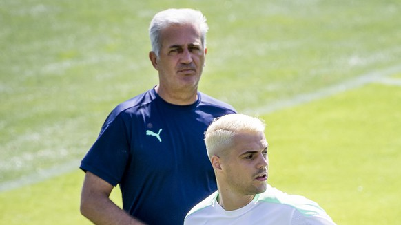 Switzerland's head coach Vladimir Petkovic, left, and Switzerland's midfielder Granit Xhaka, right, react during a training session for the Euro 2020 soccer tournament at the Tre Fontane sports centre, in Rome, Italy, Tuesday, June 15, 2021. The Swiss national soccer team will play Italy in Group A on Wednesday during the UEFA EURO 2020 soccer championship in Rome, Italy. (KEYSTONE/Jean-Christophe Bott)