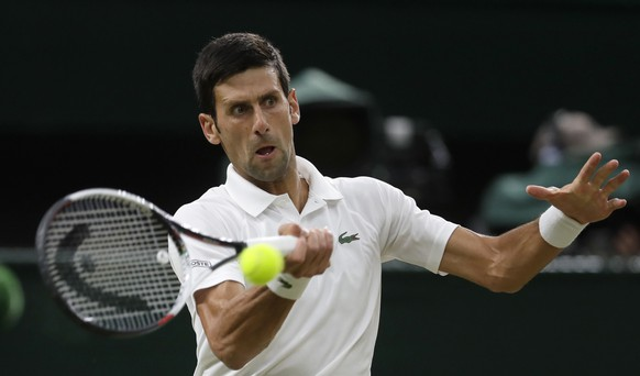 Serbia's Novak Djokovic returns the ball to Rafael Nadal of Spain during their men's singles semifinals match at the Wimbledon Tennis Championships, in London, Friday July 13, 2018.(AP Photo/Kirsty Wigglesworth)