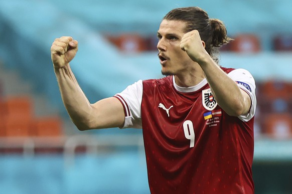 Austria's Marcel Sabitzer celebrates after the Euro 2020 soccer championship group C match between Ukraine and Austria at the National Arena stadium in Bucharest, Monday, June 21, 2021. (Marko Djurica/Pool via AP)
