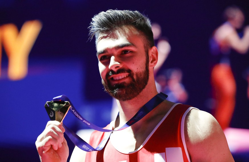 Oliver Hegi of Switzerland celebrates after winning the gold medal on the horizontal bar during the men's artistic gymnastics finals at the European Championships in Glasgow, Scotland, Sunday, Aug. 12, 2018. (AP Photo/Darko Bandic)