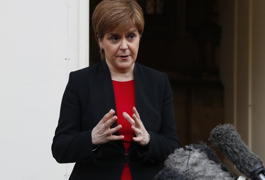 Scotland's First Minister Nicola Sturgeon speaks to the media outside the Houses of Parliament in London, Wednesday, April 3, 2019. With Britain racing toward a chaotic exit from the European Union within days, Theresa May veered away from the cliff-edge Tuesday, saying she would seek another Brexit delay and hold talks with the opposition to seek a compromise.(AP Photo/Alastair Grant)