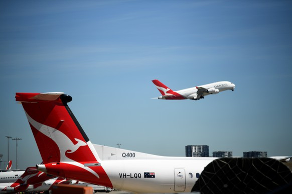 epa08305423 A Qantas aircraft takes off from Sydney Airport in Sydney, Australia, 19 March 2020. According to media reports on 19 March 2020, Qantas has suspended all international flights and will stand down two-thirds of its 30,000-strong workforce until the end of May, due to the coronavirus pandemic.  EPA/JOEL CARRETT AUSTRALIA AND NEW ZEALAND OUT