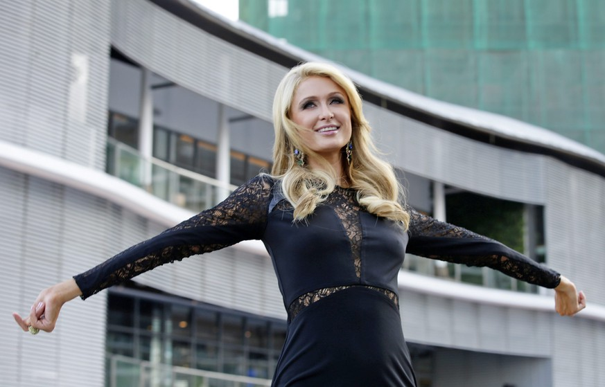 epa04123149 US personality Paris Hilton poses for photographers during the inauguration of the Paris Beach Club at Azure Urban Resort Residences in Paranaque City,  south of Manila, Philippines, 13 March 2014. Hilton led the inauguration of her first real estate project named after her.  EPA/DENNIS M. SABANGAN