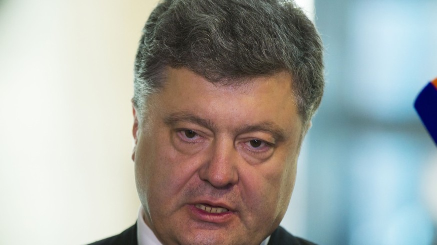 Ukranian presidential candidate Petro Poroschenko (C) talks to the media after talks with Andreas Schockenhoff (not pictured) of the ruling Christian Democratic Union (CDU) party in Berlin, May 7, 2014. Poroshenko urged Europe and the United States to agree on a third wave of sanctions against Russia if the Kremlin supports a referendum organised by separatists in eastern Ukraine on May 11. REUTERS/Thomas Peter (GERMANY - Tags: POLITICS)