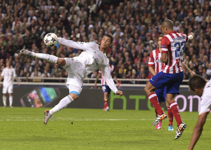 FILE - In this May 24, 2014 file photo Real's Cristiano Ronaldo kicks the ball near to Atletico's Miranda during the Champions League final soccer match between Atletico Madrid and Real Madrid, at the Luz stadium, in Lisbon, Portugal. Ronaldo is one of the three finalists for the Ballon d'Or, the FIFA World Player of the Year award.   (AP Photo/Manu Fernandez, files)