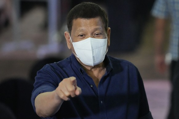 Philippine President Rodrigo Duterte gestures as he accompanies some of PDP-Laban political party's senators slated for next year's elections with the Commission on Elections in Manila, Philippines on Friday, Oct. 8, 2021. (AP Photo/Aaron Favila, Pool) Rodrigo Duterte